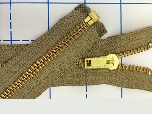 brass on tan jacket zipper